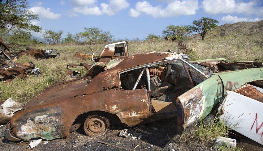 rusted car in junkyard