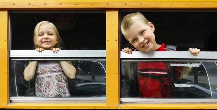 kids on their way to school in the bus